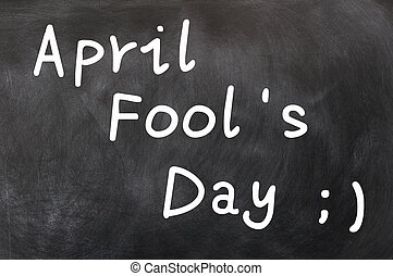 April Fools Day written with white chalk on a blackboard