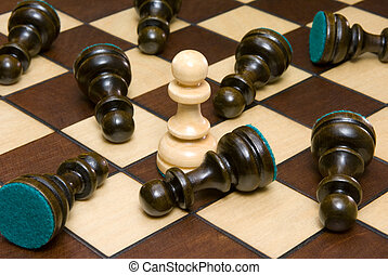 Fast victory - Chessmen on a chess board (black and white...