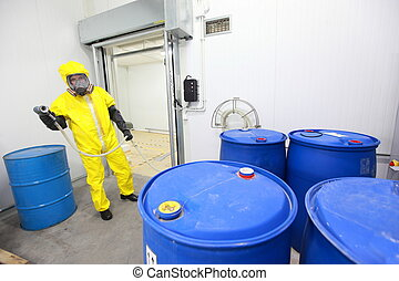worker dealing with toxic substance - Fully protected in...