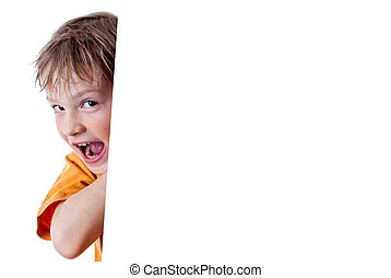 Portrait of a happy small boy holding a blank board against...