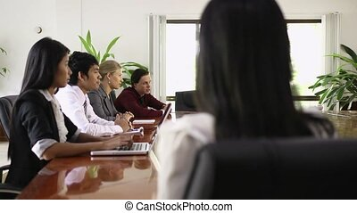 Asian businesswoman smiling at work