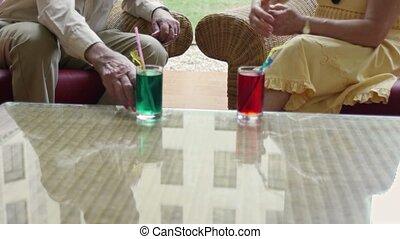 bar, senior man and woman drinking