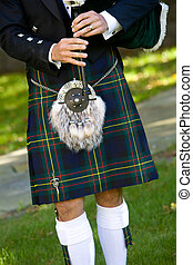 Bagpiper - Scottish bagpiper playing bagpipes. This is a...