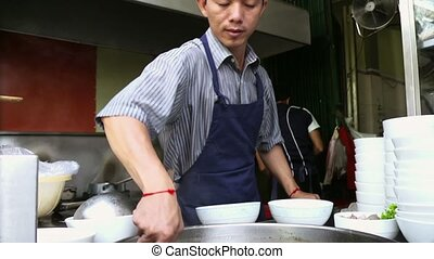 Man working as cook in kitchen