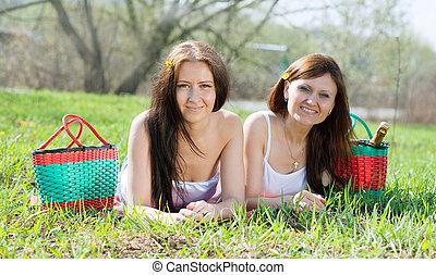 happy women relaxing in  park