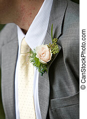 Man wearing a corsage - A grooms wedding boutonniere in pink...