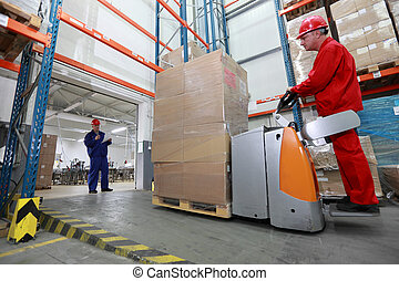 goods delivery in plant - Goods delivery - two workers with...