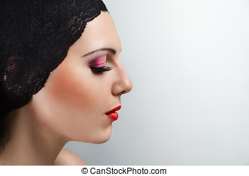 Young woman profile portrait - Side view studio portrait of...