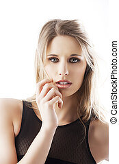 natural blond woman, her hand is near the face