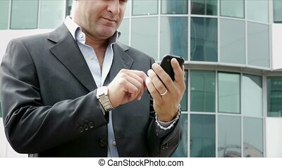 man sending emails with phone