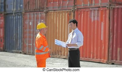 Manager and worker in industry - Worker, manager and cargo...