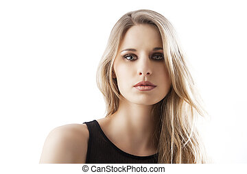 natural blond woman, she looks in to the lens