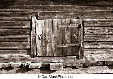 wooden door in rural barn, sepia