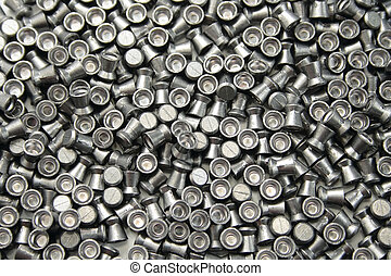 airgun pellets background - numerous airgun lead pellets as...