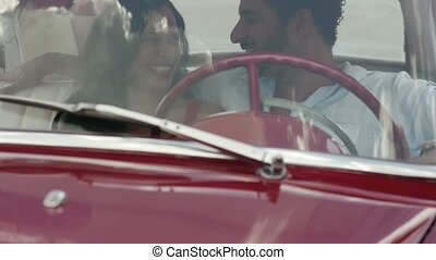 girlfriend and boyfriend in red car - young happy man and...