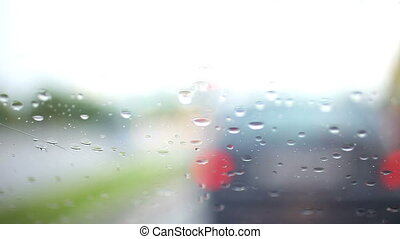 View from car on the rain and cars