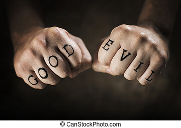"Good or Evil - Man with ""Good"" and ""Evil"" fake tattoos."