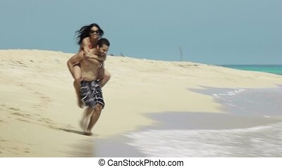 piggyback ride with man and woman