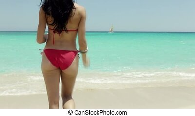 young woman with swimsuit on beach