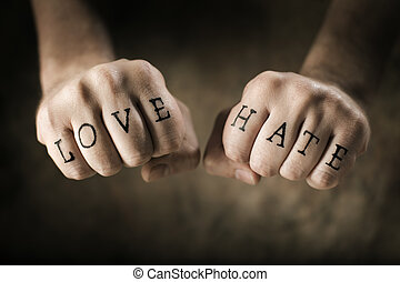 Love and Hate - Man with fake Love and Hate tattoos on his...