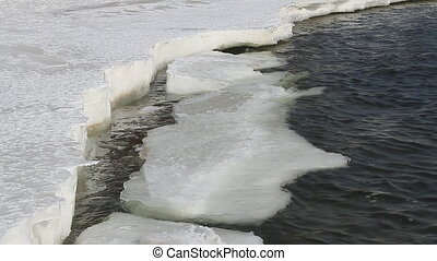 Icy water 007 - Ice floes on river bank.