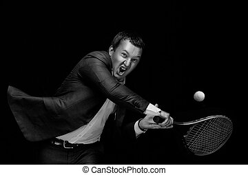 Ready to hit! - A portrait of a tanned businessman tennis...