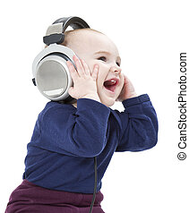young laughing child with ear-phones listening to music