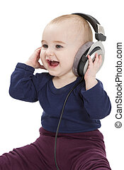 young child with ear-phones listening to music - young...