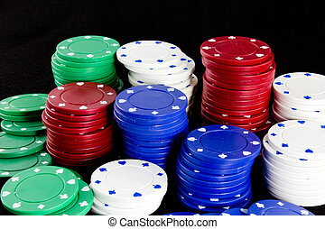 Casino Chips - Colorful casino chips against a black...