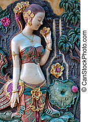 Thai's ancient woman standing in front of a tree. - Thai...