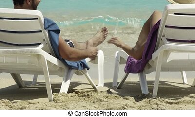 man and woman doing honeymoon - husband and wife relaxing on...