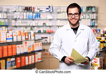 young pharmacist - portrait of young handsome pharmacist