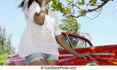 young woman on the phone near car - young adult brunette...