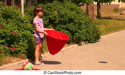 The child catches the ball bag