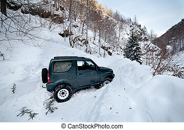Car stuck in a snow avalanche - 4x4 car being stuck in a...