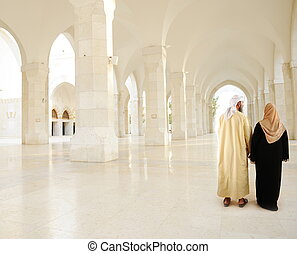 Muslim Arabic couple indoor, White mosque