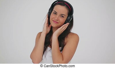 Peaceful woman wearing her headphones