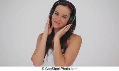Peaceful woman wearing her headphones