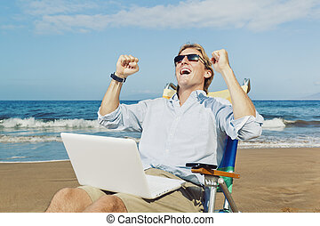 Young Attractive Man Celebrating Success, Working on...