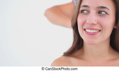 Hairdresser brushing the hair of a smiling woman