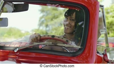 Beautiful woman in cabriolet car