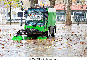 sweeping machine picking the leaves of the trees