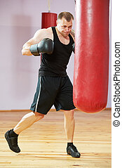 boxer man at boxing training with heavy bag - boxer man...