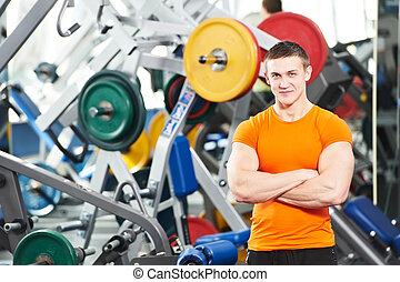 bodybuilder man doing biceps muscle exercises - Smiling...