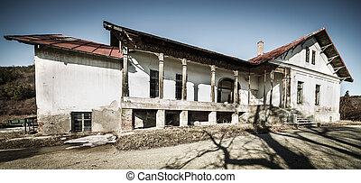 Decrepit house - Moody split toned landscape with a decrepit...