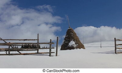 Haystacks in winter at Carpathians, Ukraine. Shot with slider.
