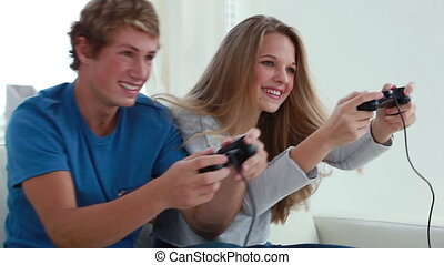 Happy couple playing video games together