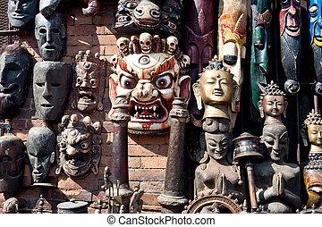 Woodcarving masks hang, Nepal