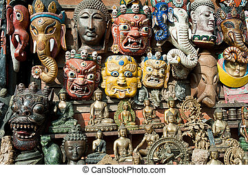 Masks, pottery,souvenirs, hanging in front of the shop,...