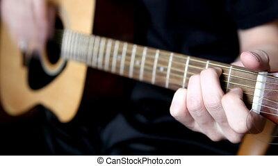 guitar - a man playing the guitar